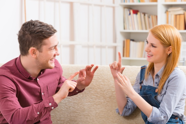 Deaf man with his girlfriend using sign language